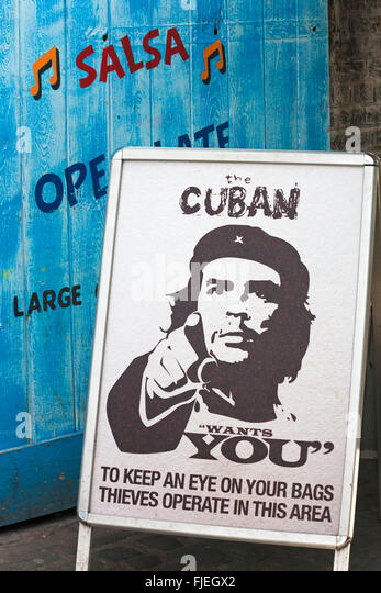 The Cuban wants you to keep an eye on your bags thieves operate in this area notice at Camden Market, London - Stock Image