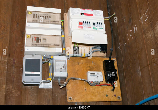 circuit board fuses fuse boards breaker breakers panel panels wiring household building electrician electricians - Stock Image