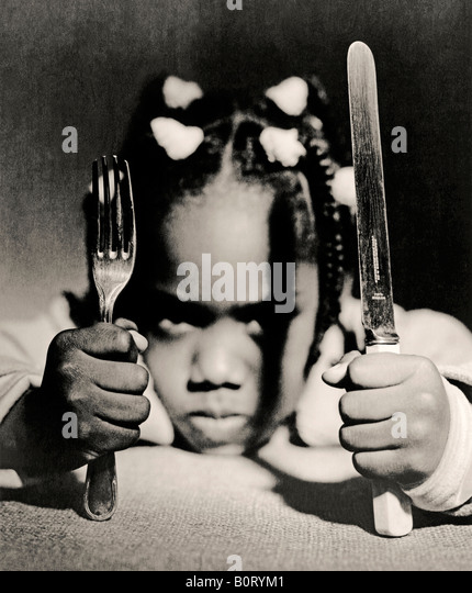 afro-Caribbean child waiting for food - Stock Image