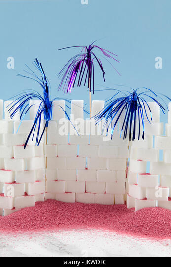 A castle built with sugar cube and cocktail palm symbolizing fireworks. Minimal and funny design still life photography. - Stock Image