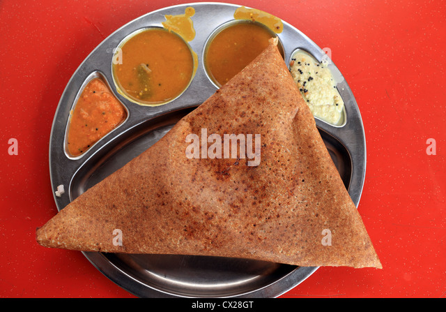 Mutton thosai dosa triangle meal in Little India, Singapore. - Stock Image
