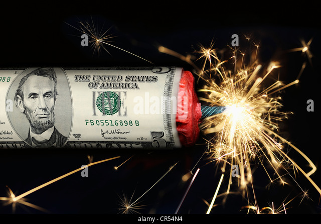 Stick of dynamite with a US-Dollar with a burning fuse, symbolic image of the U.S. national debt - Stock Image