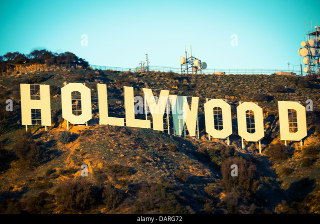The iconic Hollywood sign with a blue sky background - Stock Image