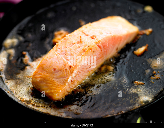 Salmon fillet cooking in butter/step shot - Stock Image