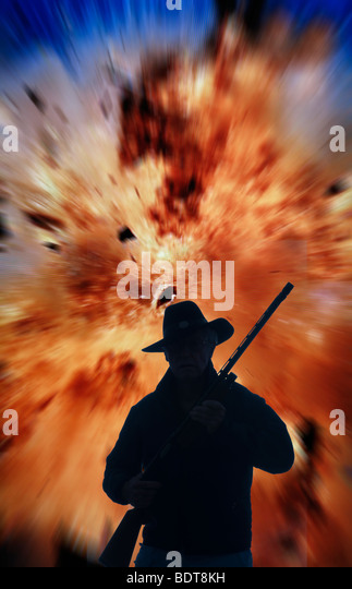 armed terrorist running from explosion - Stock Image