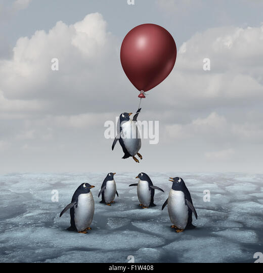 Advantage business concept and leadership innovation metaphor as a group of penguins standing on ice with one individual - Stock-Bilder