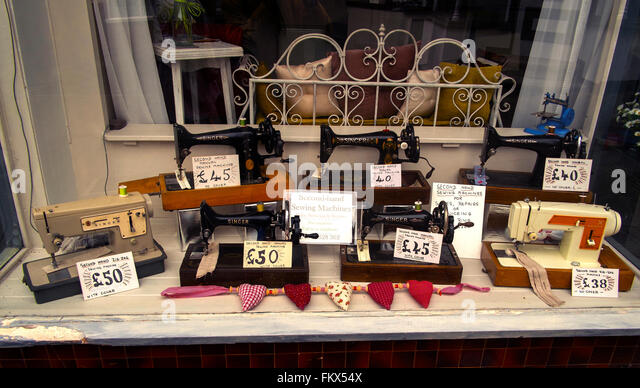 Singer sewing machines shop window display - Stock Image