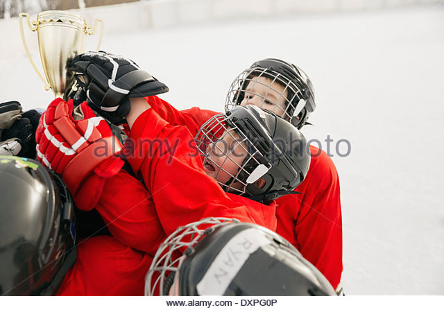 Ice hockey team holding trophy - Stock Image