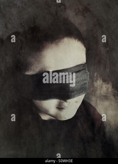 Blindfolded boy - Stock Image