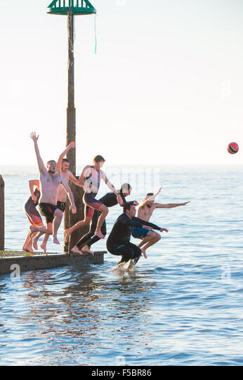 Aberystwyth, Wales, UK, 1st November, 2015.   A group of university students cool off in the sea on  a day of unbroken - Stock Image