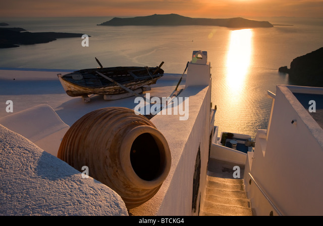 Boat on roof terrace Firostefani Santorini Cyclades Islands Greece at sunset - Stock Image