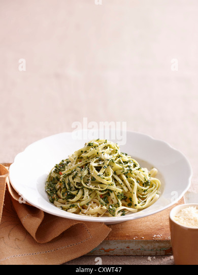 Plate of pesto pasta - Stock Image