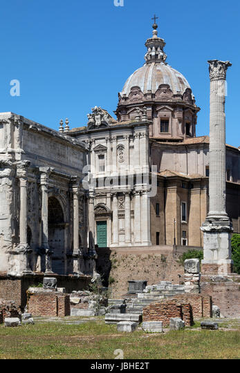 The Roman Forum - Rome Italy. The Arch of Septimius Severus, the church of Santi Luca-e-Martina and the Column of - Stock Image