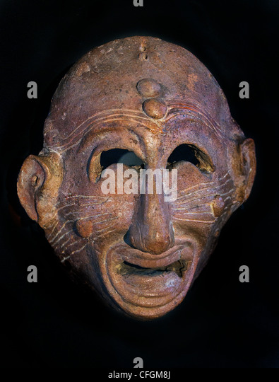 Grimacing apotropaic mask ( away bad luck )  Terracotta, late 7 - 6th cent BC Carthage Tunisia - Stock Image