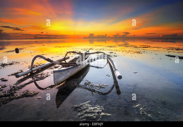 Indonesia, Bali, Boat on shallow during sunset - Stock Image