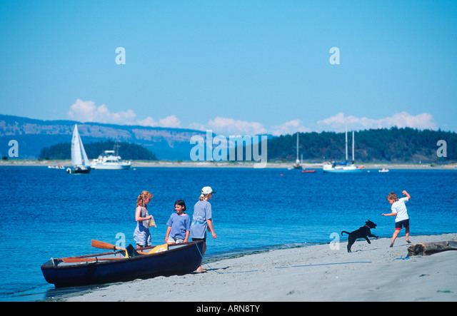 Sidney Spit - children play on beach, Vancouver Island, British Columbia, Canada. - Stock Image