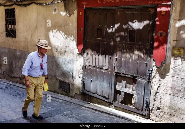 Spain Europe Spanish Hispanic Toledo Hispanic man hat resident walking - Stock Image