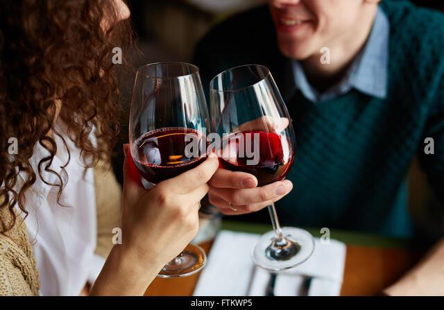 Toasting with red wine - Stock-Bilder