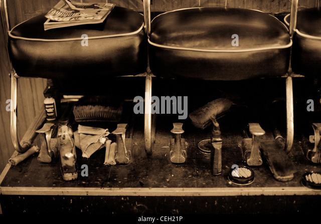 Interior of shoe shine store with leather seats - Stock-Bilder