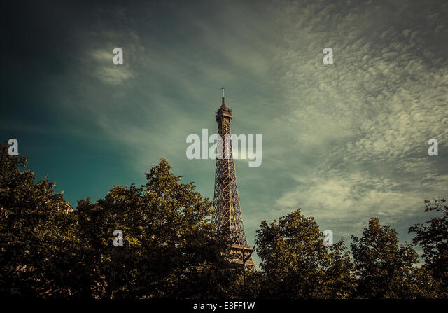 Eiffel Tower above treetops, Paris, France - Stock Image