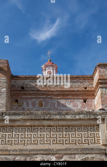 Glifos and church steeple at the Mitla, Oaxaca archaeology site in Mexico. - Stock Image