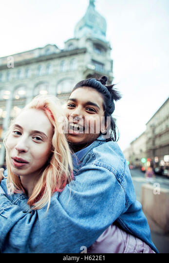 cute young couple of teenagers girlfriends having fun, traveling - Stock Image