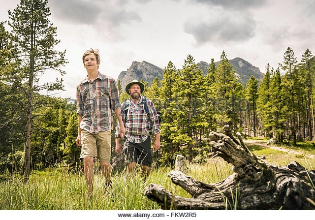 Front view of father and son hiking in mountains, Red Lodge, Montana, USA - Stock Image