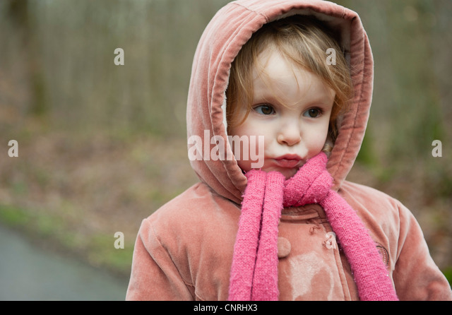 Little girl making face, portrait - Stock Image