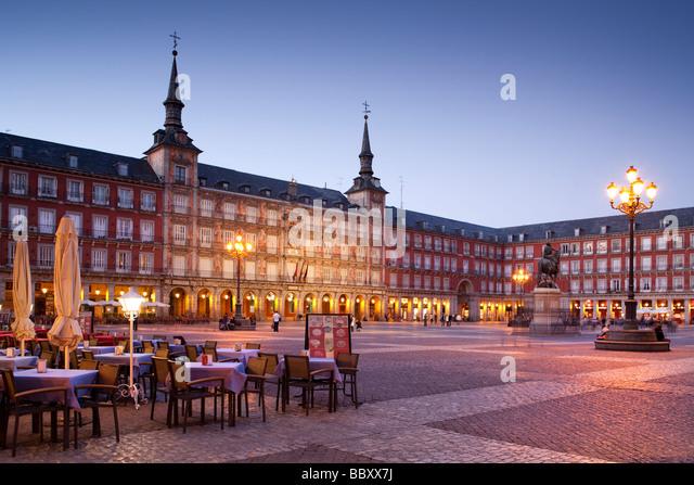 Plaza Mayor illuminated with pavement cafes, Madrid, Spain - Stock Image