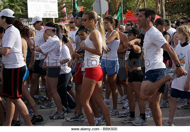Miami Beach Florida Ocean Drive South Pointe 5K Run benefit runners race compete starting line man woman boy teen - Stock Image