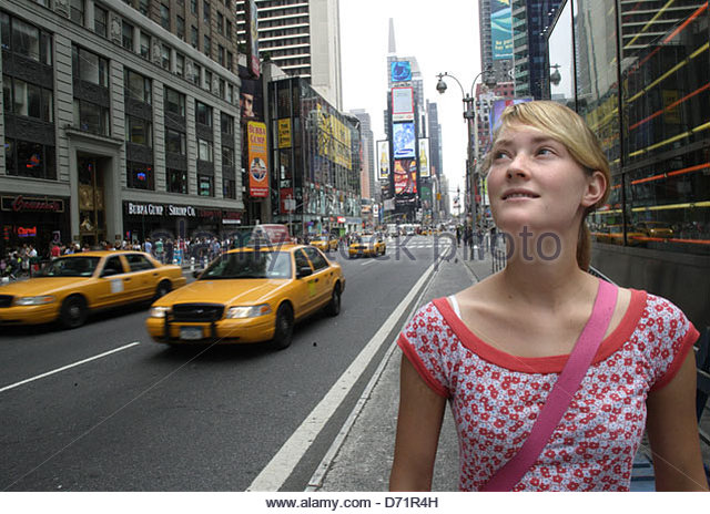 Woman walking along a road in a city, 42nd Street, Time Square, Manhattan, New York City, New York State, USA - Stock-Bilder