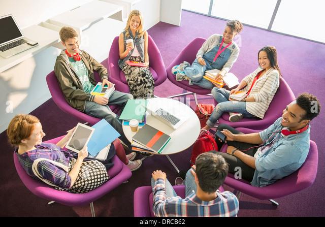 University students talking in circle - Stock Image