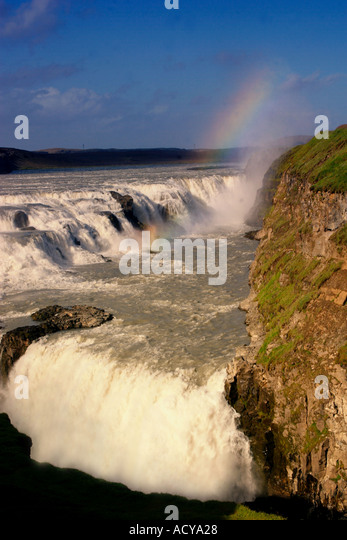 Iceland Gulfoss waterfall sunset rainbow - Stock Image