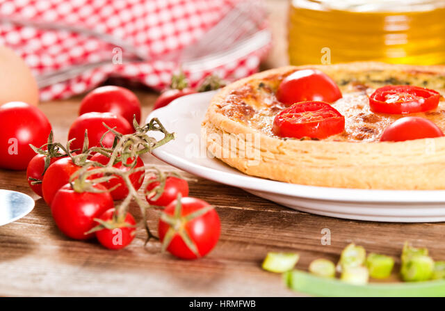 Leek and tomato quiche. - Stock Image