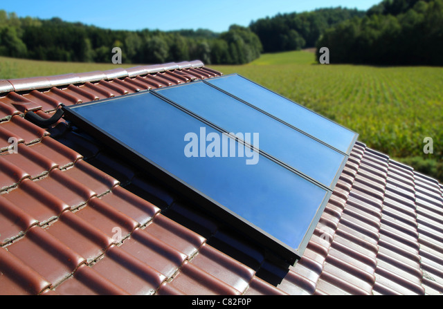 Solar collector on a cottage in the country - Stock Image