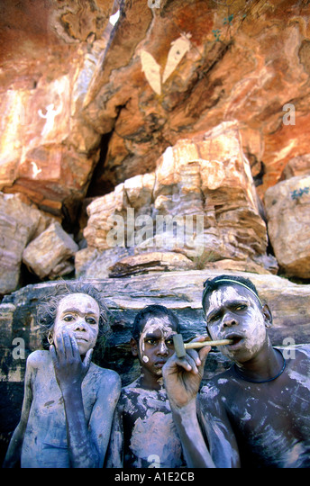 Aboriginal Rembargna clan boys paint up with white pipe clay when visiting significant sacred site Dukuladjarranj - Stock Image