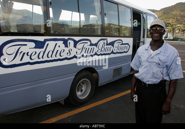 BVI Tortola Road Town Black male Freddie's Fun Bus Tours - Stock Image