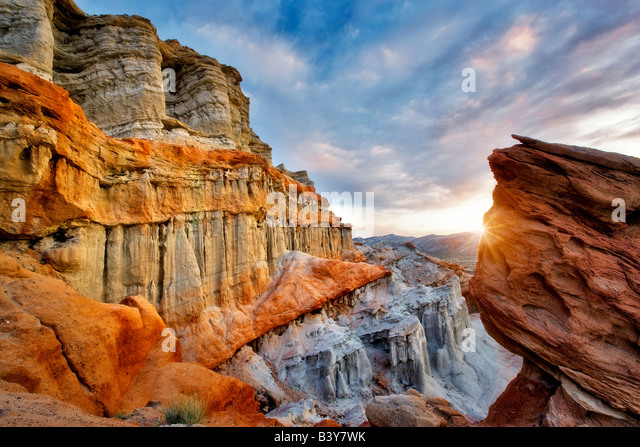 Puffy clouds and colorful sandstone rocks at Red Rock Canyon State Park California - Stock Image