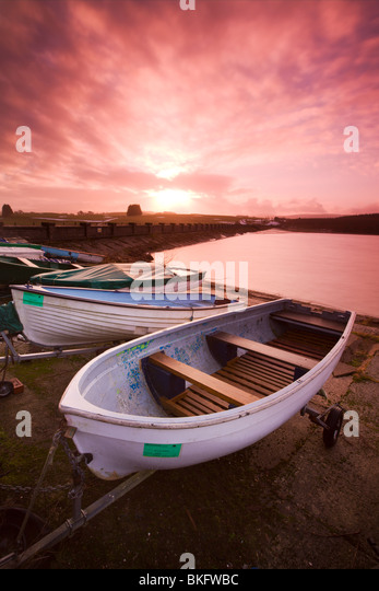Fishing boats beside the Usk Reservoir at sunrise, Brecon Beacons National Park, Wales, UK. Winter (January) 2010. - Stock Image