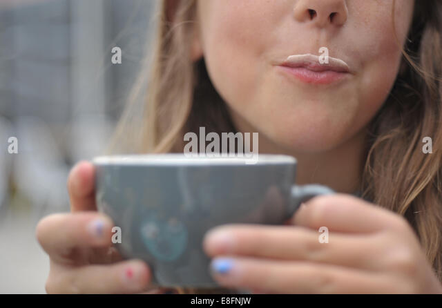 Girl with a milk moustache - Stock Image