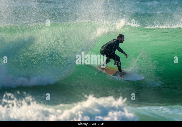 A surfer in spectacular action at Fistral in Newquay, Cornwall. UK. - Stock-Bilder