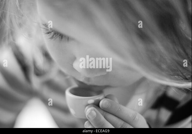 Argentina, Buenos Aires, Little girl drinking tea - Stock Image