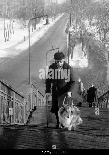 History teacher Pavel Belov with his dog - Stock Image