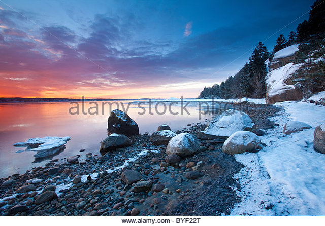 Colorful skies at daybreak at Oven in Råde, Østfold fylke, southeastern Norway. - Stock Image