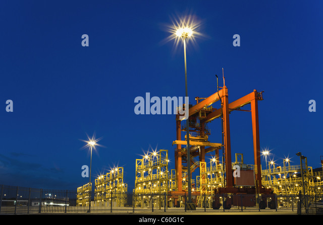 Container crane machinery in shipyard - Stock Image
