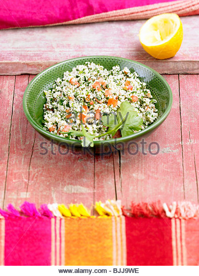 Tabbouleh in a bowl (Bulgur salad, Lebanon) - Stock Image