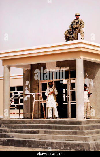 Alaskan National Guard provides security from the roof of the Sanjaray clinic. - Stock Image