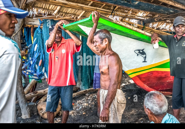 A group of traditional fishermen having conversation in Lamalera village, Lembata Island, Indonesia. © Reynold - Stock Image