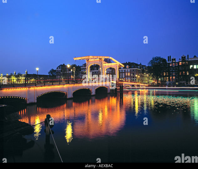 Amsterdam Magere Brug famous old drawbridge at dawn over river Amstel  - Stock Image