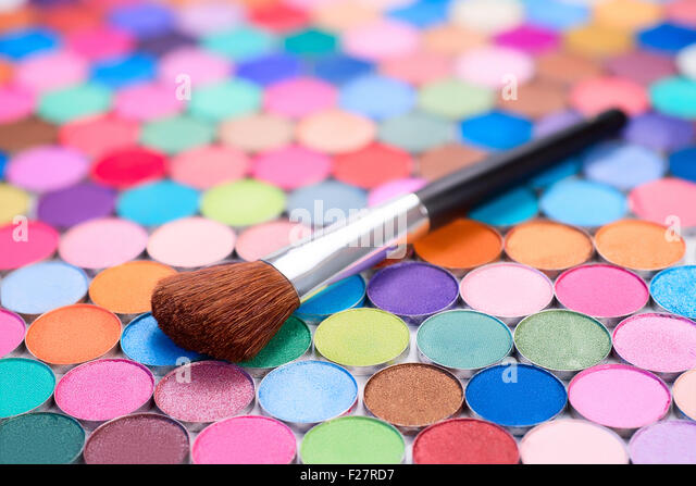 background with make-up brush and many multicolored eye shadows - Stock-Bilder
